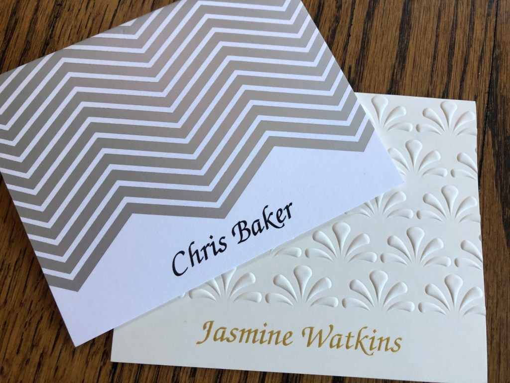 Two personalized folded notes from Embossed Graphics featuring names printed in black and gold raised ink.