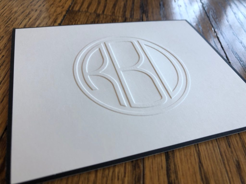 A monogrammed folded note from Embossed Graphics with a black border to give it more sophistication.