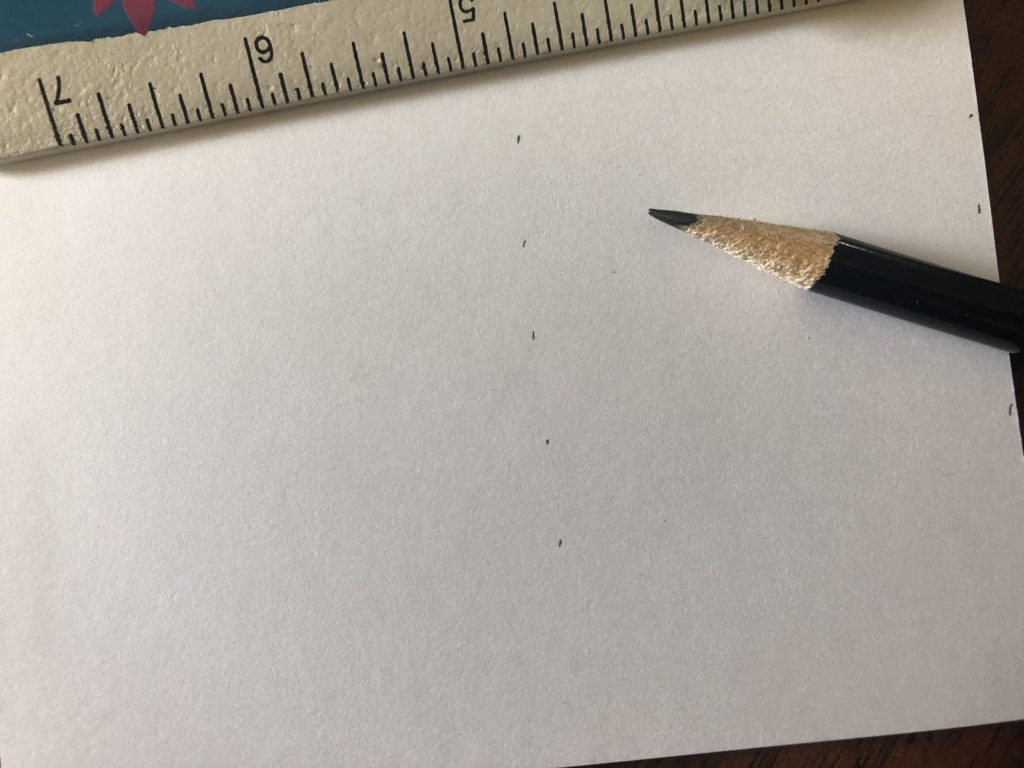 Use a ruler and pencil to help your handwriting move in a straight line across your letter.